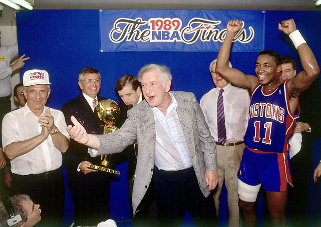 Pistons owner Bill Davidson celebrates with Isiah Thomas during the NBA Championship Trophy presentation.