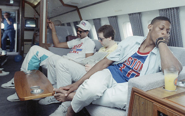 Rodman and Edwards unwind on the team plane as the Pistons returned to Detroit following their Finals victory over the Lakers.