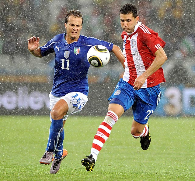 Gilardino (left) was ineffective, blunt and failed to add a cutting edge to an increasingly old and toothless Italian team.