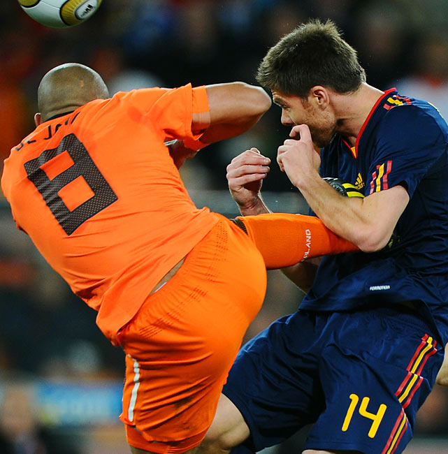 The Netherlands' Nigel de Jong got away with a kung-fu kick to the chest of Spain's Xabi Alonso with just a yellow card in the first half. The Dutch played a physical style to try and break up Spain's rhythm.