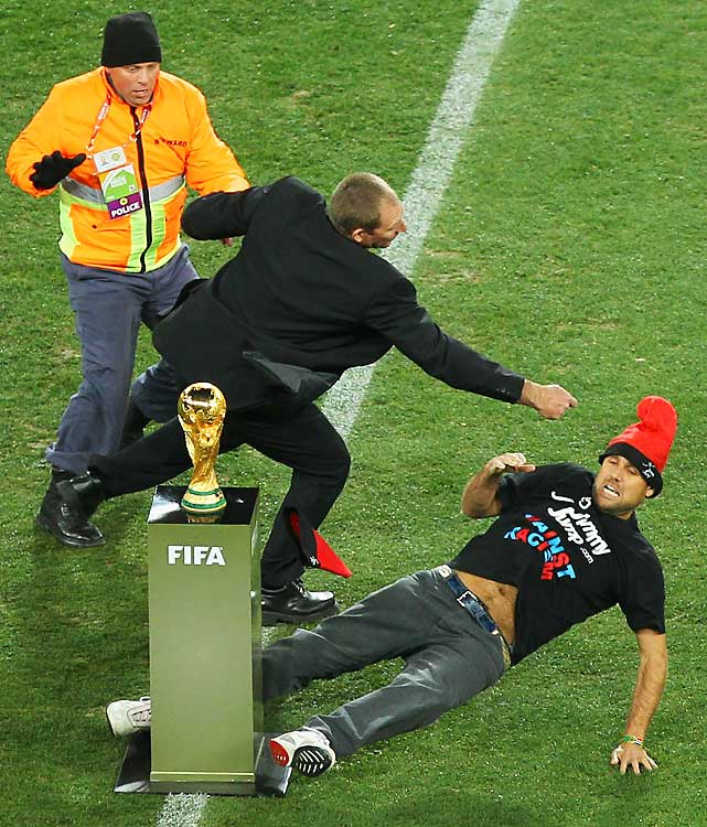 A fan rushed the field and ran toward the iconic World Cup trophy before the introductions. Just before he reached it, a security guard leveled him to the pitch with a powerful punch. The World Cup was completed without a major security problem.