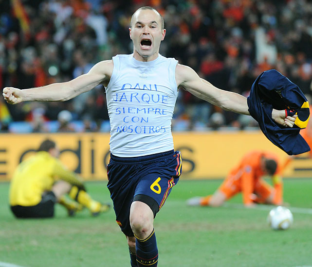 "Andres Iniesta celebrated his goal by ripping off his shirt (an automatic, yet well-worth-it yellow card) to show a message translated to ""Dani Jarque is always with us,"" a tribute to a former teammate who died of a heart attack last year."
