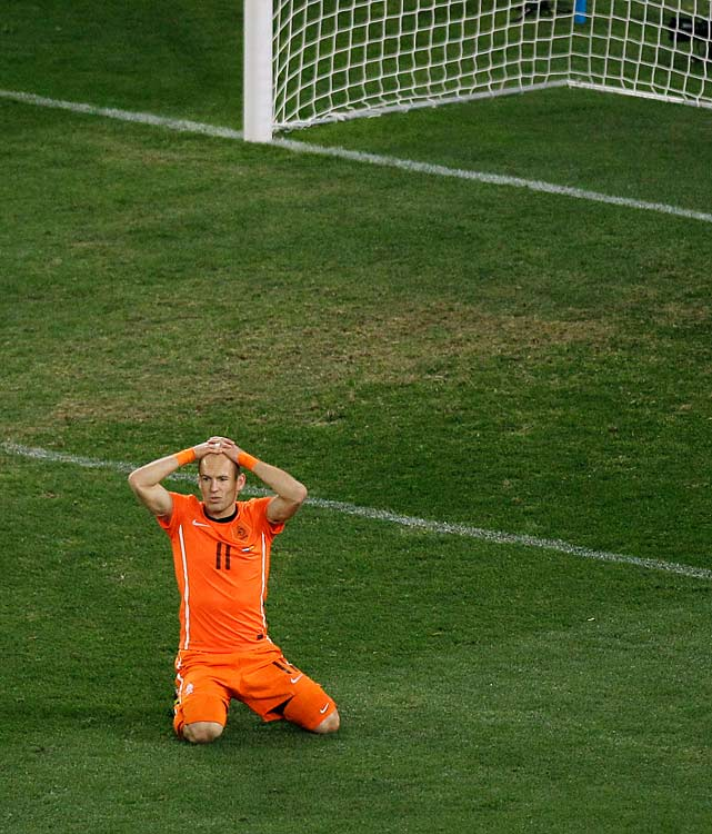 The Dutch's Arjen Robben reacts after missing his best scoring chance of the match. Robben had a one-on-one with Spanish keeper Iker Casillas, but Casillas poked away Robben's shot with his boot. Robben, who missed the first two matches with an injury, turned into his country's top scoring threat by the end of the tournament.