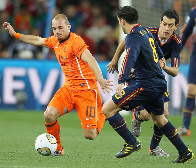 Perhaps the most important players for each team are midfielders. The Netherlands' Wesley Sneijder (left) scored five times in the World Cup but was bottled up in the final. Spain's Xavi (right) was a master passer throughout, running the Red Fury attack.