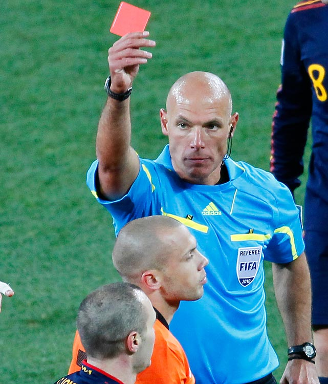 Referee Howard Webb handed out a World Cup final record 14 yellow cards and one red card, to the Netherlands' John Heitinga, in a foul-marred match.