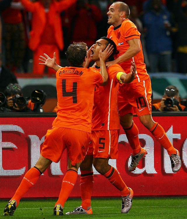 After his beautiful strike, van Bronckhorst celebrated and was flanked by teammates Wesley Sneijder (right) and Joris Mathijsen (4). Van Bronckhorst's goal came on his first shot of the World Cup.