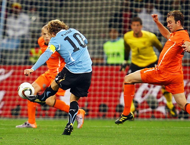 Equalizing the match at 1-1, Uruguay's Diego Forlan took a long-range shot that skimmed off the hand of Dutch goalkeeper Maarten Stekelenburg.