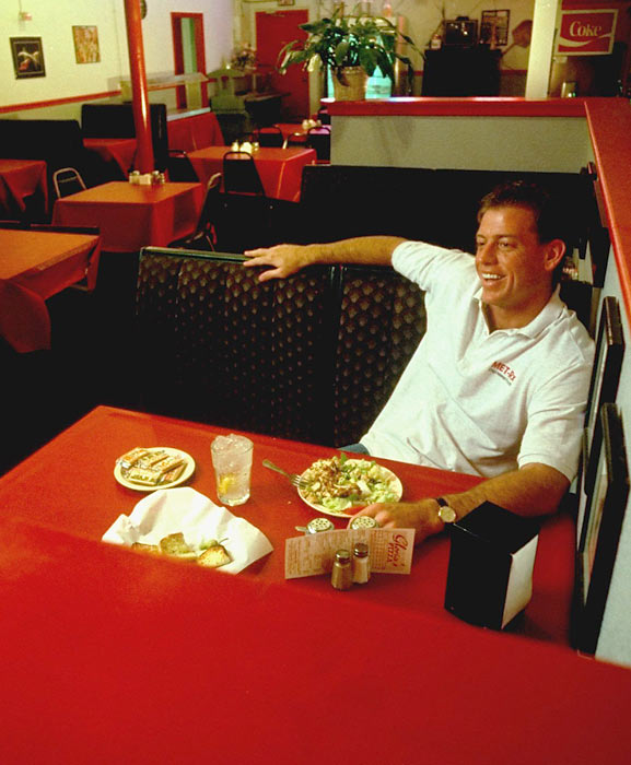 Dallas QB Troy Aikman sits alone at Gloria's Pizza restaurant outside Dallas.