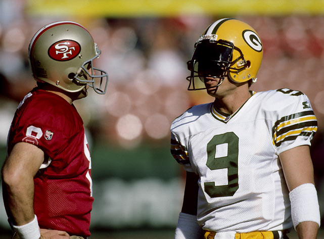 San Francisco quarterback Steve Young talks with Green Bay backup quarterback Jim McMahon before a Packers-49ers game.
