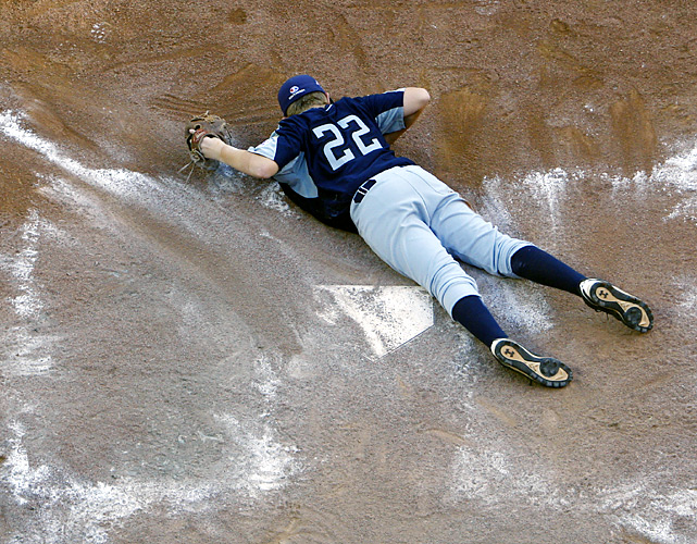 Jaron Roblyer lies on the ground after allowing the game-ending run. Texas will play Taiwan for third place.