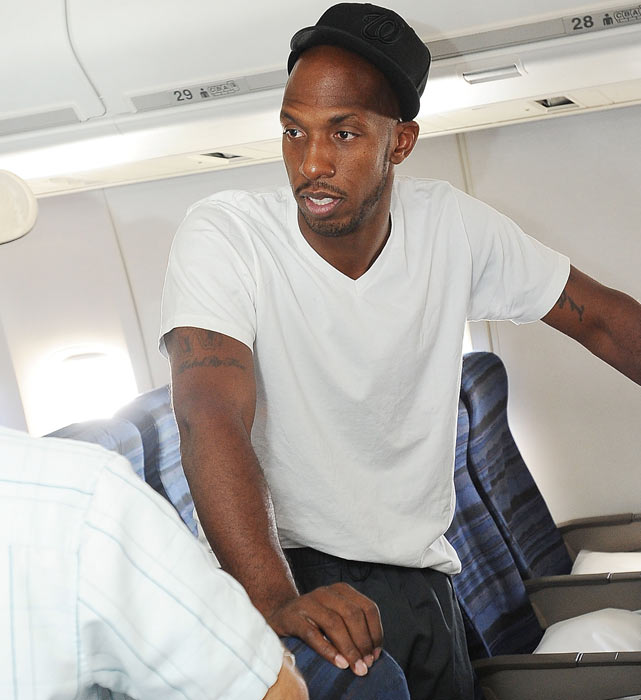 Chauncey Billups speaks with teammates on the Nuggets charter plane.