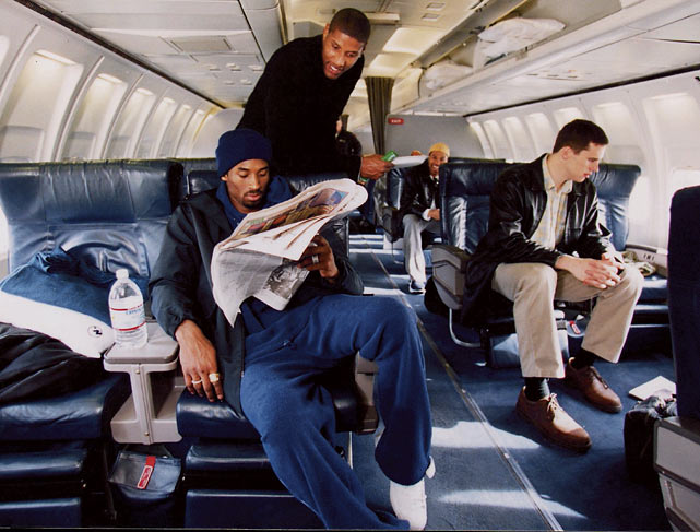 Kobe Bryant catches up on his reading while aboard the Lakers' charter plane.
