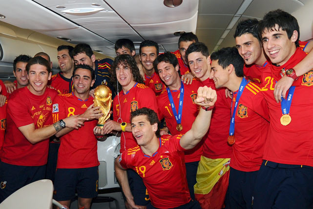 Spanish players celebrate on the plane before their arrival at Barajas' airport in Madrid, a day after winning the World Cup for the first time 1-0 against Holland.