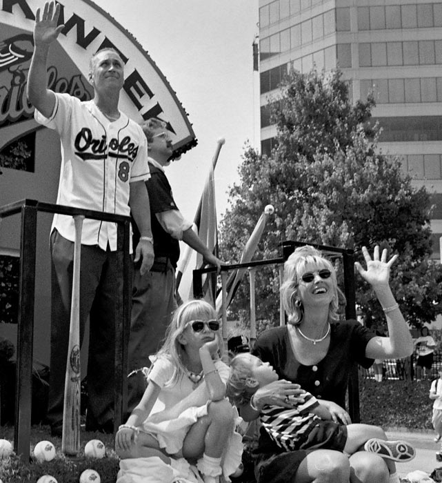 Ripken, wife Kelly, daughter Rachel and son Ryan are the center of attention during a parade in downtown Baltimore to celebrate Ripken's record.