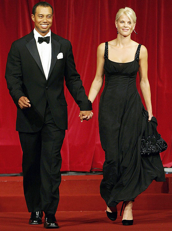 Elin and Tiger walk down the catwalk during the Ryder Cup Gala dinner in 2006.