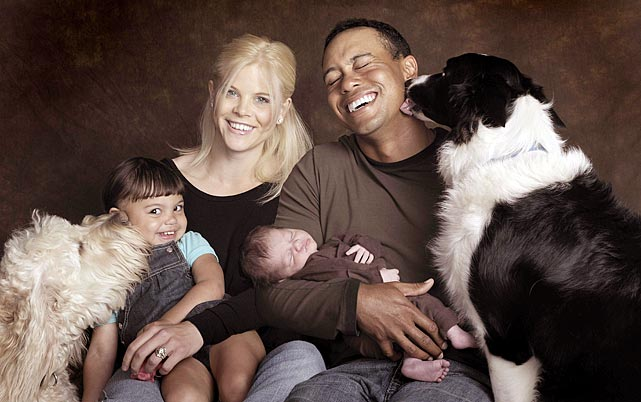 Elin and Tiger with their kids Sam and Charlie, and their dogs Yogi (left) and Taz.
