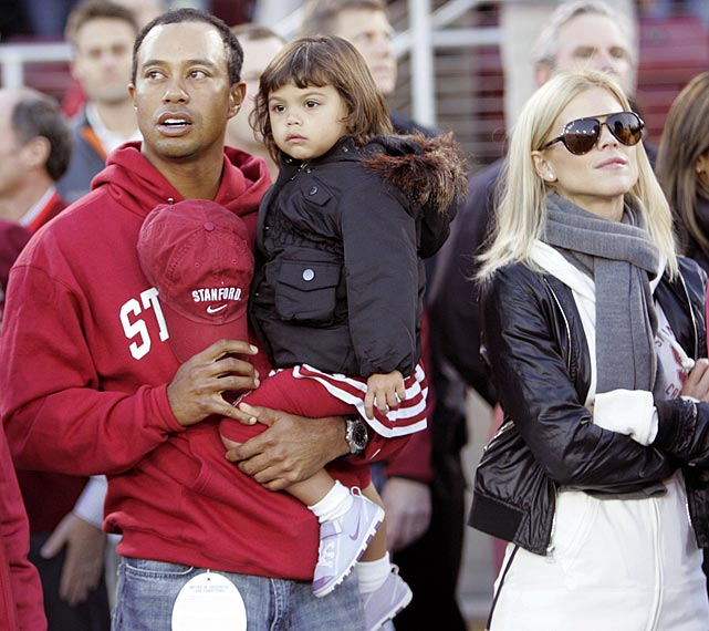 Elin, Tiger and daughter Sam take in Stanford Stadium before a California Bears-Stanford Cardinals game in November 2009.