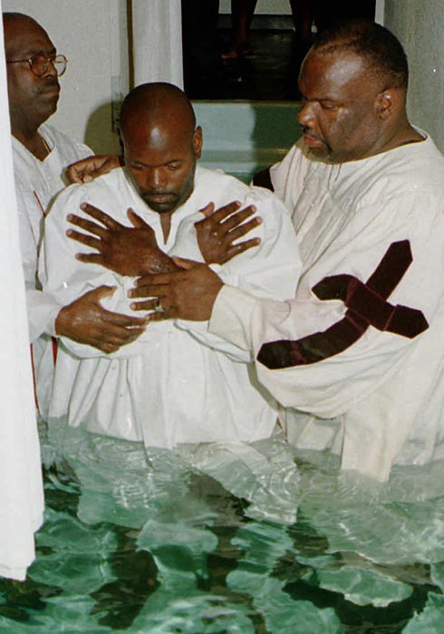 Smith was baptized by the Rev. T.D. Jakes (right) during a ceremony at The Potter's House Church in Dallas.