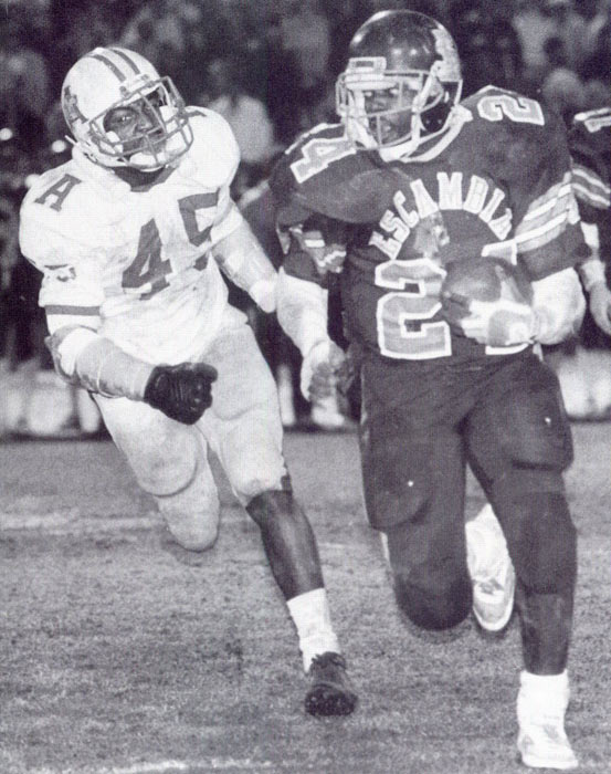As Emmitt Smith observes his 49th birthday (May 15), SI looks back at some rare photos of the Cowboys' legend. During his days at Escambia High in Pensacola, Fla., Smith ran for nearly 9,000 yards and scored over 100 touchdowns.