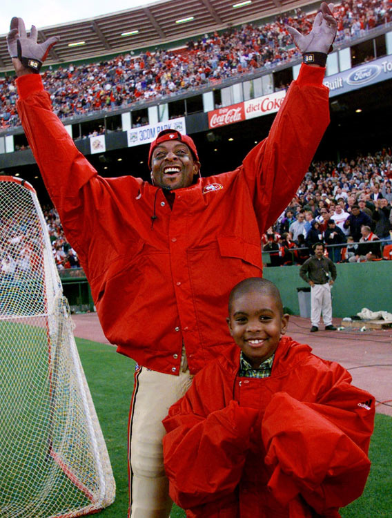 The preseason was one of the few times Rice could watch his team score touchdowns without being on the field. Like this shot in 1999, when Rice, with his son, took in a 49ers touchdown in the third quarter from the sidelines.