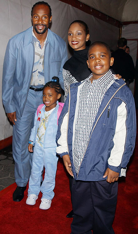 Family guy: Rice attends the McDonald's All-American banquet with his wife, daughter and son.