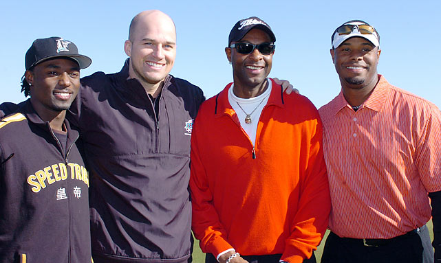 Rice smiles with (from left to right) current Jets wide receiver Santonio Holmes, Seahawks quarterback Matt Hasselbeck and baseball legend Ken Griffey Jr. Rice and Hasselbeck hooked up for two touchdowns during Rice's brief tenure with Seattle.