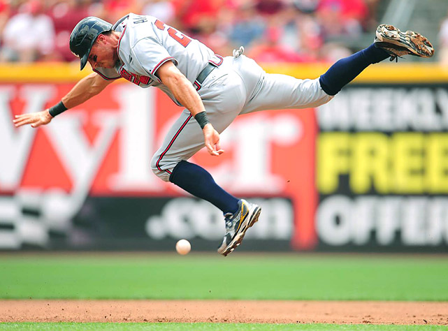 Atlanta Braves right fielder Rick Ankiel leaps to get out of the way of a ground ball hit by Melky Cabrera in the second inning of their game at Cincinnati Reds on Aug. 1 at Great American Ballpark. The Reds defeated the Braves 2-1.