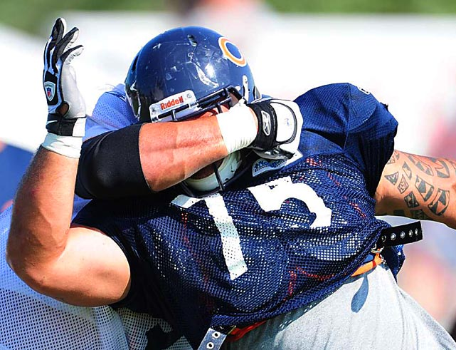 Chicago Bears defensive tackle Matt Toeaina takes a shot to the head from a teammate during training camp practice on Aug. 5 at Olivet Nazarene University in Bourbonnais, IL.