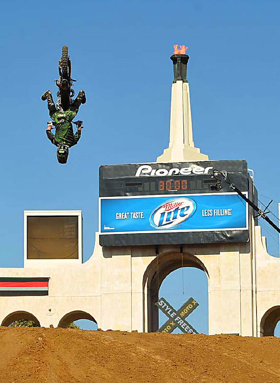 Adam Jones goes upside down during Moto X Freestyle competition at X Games 16 at the Los Angeles Coliseum on July 28. Travis Pastrana won the event.
