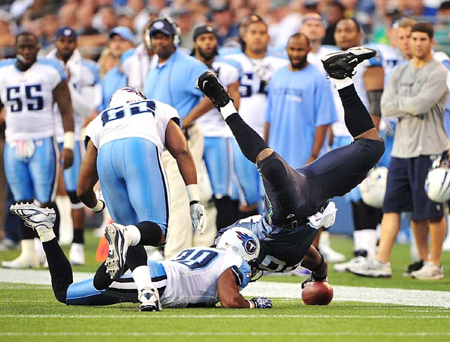 Seattle Seahawks wide receiver Chris Baker is tackled by Tennessee cornerback Ryan Mouton after a five-yard gain at Qwest Field in Seattle on Aug. 14. The Seahawks won 20-18.
