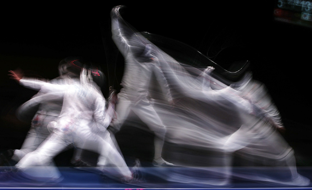 Tevfik Burak Babaoglu of Turkey (L) in action against Kwang Hyun Lee of Korea during the Cadet Male Individual Foil Bronze medal match at the Youth Olympics.