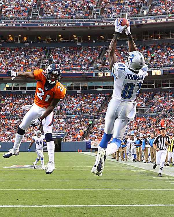 Calivin Johnson of the Detroit Lions makes a 20-yard touchdown catch over Andre Goodman of the Denver Broncos at Mile High on Aug. 21. The Lions won 25-20.