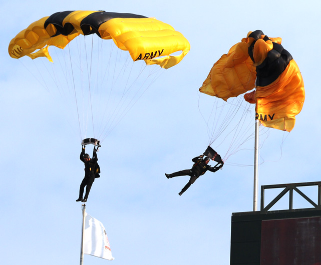 A member of the Army Golden Knights parachute team gets caught up on an outfield flagpole during pregame activities of the game Aug. 24 between the Minnesota Twins and the Texas Rangers. The Rangers won 4-3 at the Rangers Ballpark in Arlington.