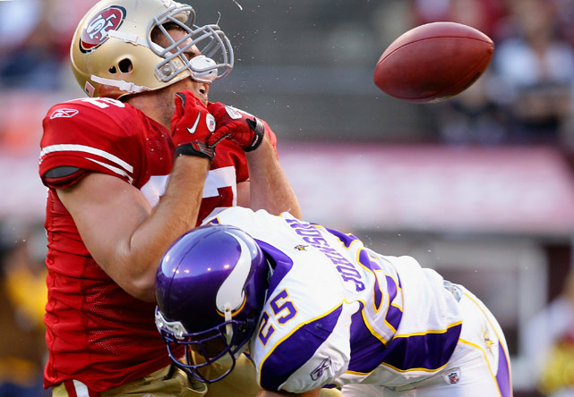 Tight end Nate Byham of the San Francisco 49ers is hit by safety Tyrell Johnson of the visiting Minnesota Vikings during a preseason game at Candlestick Park on Aug. 22.  The 49ers defeated the Vikings 15-10.