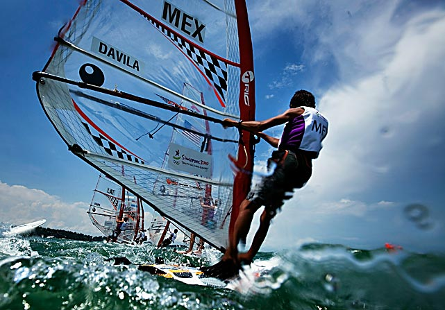 Jose Davila of Mexico and other competitors cross the start line during a race of the Boys Techno 293 Windsurfer on day nine of the Youth Olympics at The National Sailing Centre on Aug. 23 in Singapore.