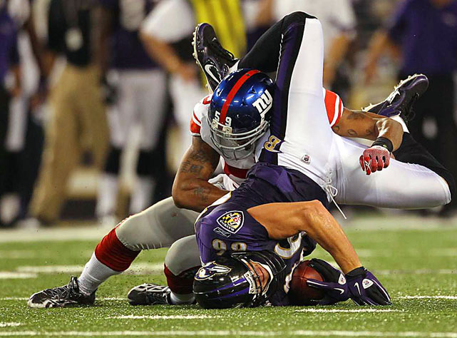 Baltimore Ravens tight end Todd Heap is hit by New York Giants linebacker Michael Boley during the second quarter of their preseason game Aug. 28 in Baltimore. The Ravens won 24-10.