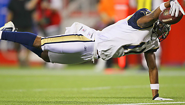 Rams wide receiver Brandon Gibson dives for the end zone after being tripped up by Patriots cornerback Darius Butler. The 20-yard scoring catch helped St. Louis win on the road in Sam Bradford's first start, 36-35.