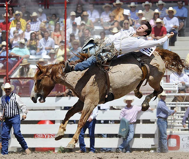 Bareback rider Clint Cannon, of Waller, Texas, lays flat on his back in the competition.