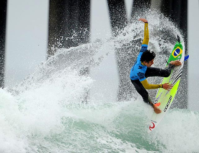 Gabriel Medina of Brazil pops an air in front of the pier in his morning quarterfinal loss to eventual finalist Jordy Smith at the U.S. Open of Surfing at Huntington Beach, Calif.