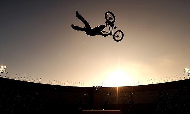 The sun starts to set during the BMX big air ramp competition.