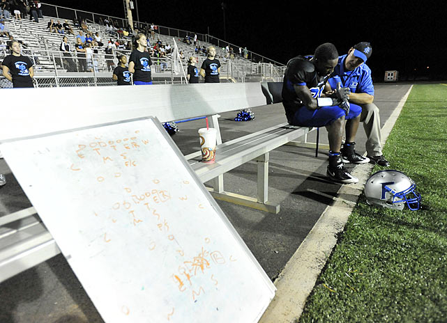 After Sept. 11, Fort Campbell was locked down. Snipers stood sentry in light towers, tanks rolled back and forth beside the practice field and every fan who attended Falcons home games had to be pre-approved.