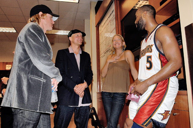 Owen Wilson, Woody Harrelson, Kate Husdon and then-Warrior Baron Davis have a chat after the Warriors' win against Dallas in Game 6 of the 2007 Western Conference quarterfinals.
