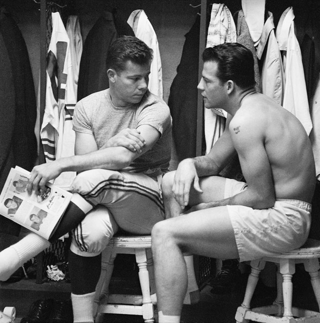 Kyle Rote (left) and Frank Gifford of the New York Giants chat before losing to the Baltimore Colts in the 1958 NFL Championship game.