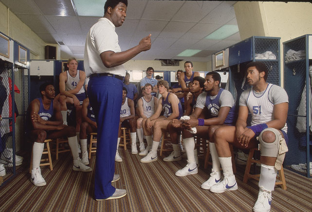 Georgetown coach John Thompson gives his players a pep talk after practice. In 1984, Thompson became the first African-American head coach to win a major college championship when his Hoyas defeated Houston for the NCAA title.