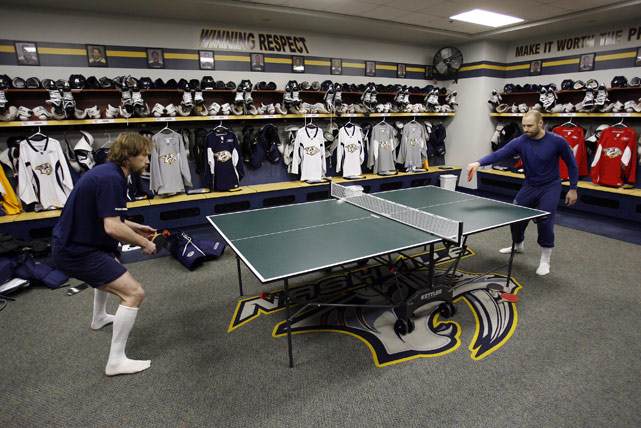 Peter Forsberg (left) plays ping-pong against Tomas Vokoun in the Nashville Predators' locker room.