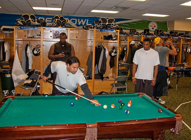 Steelers safety Troy Polamalu plays pool in the locker room of the Steelers practice facility at the University of South Florida.