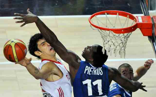 Turkey's Kerem Gonlum vies with France's Florent Pietrus during their World Championship game in Istanbul. Turkey won 95-77.