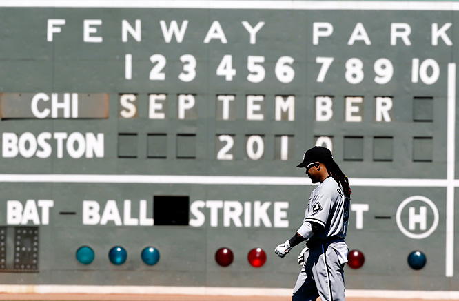 Manny Ramirez, now with the Chicago White Sox, walks across the outfield in his return to Boston.