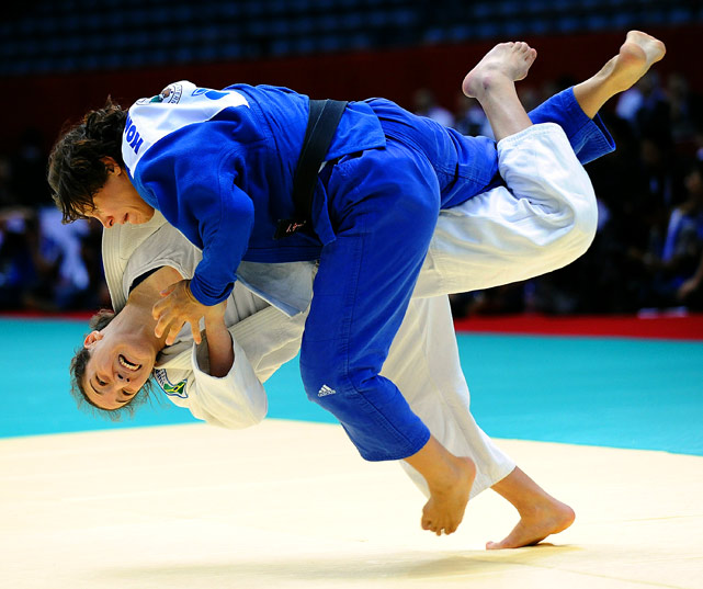 Mayra Aguiar (white) of Brazil throws Heide Wollert of Germany during the semifinal match in the 78kg class at the 2010 World Judo Championships on Sept. 9 in Tokyo.  Aguiar defeated Wollert and wound up winning the silver medal.