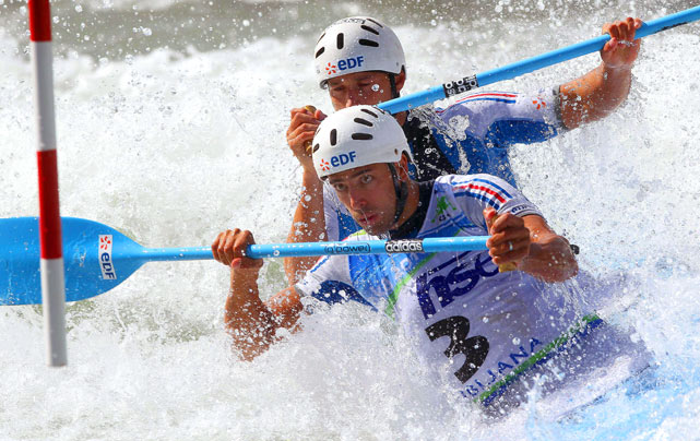Denis Chanut Gargaud (left) and Fabien Lefevre of France compete in the K-2 double seated kayak at the world championships on Sept. 11 in Tacen near the Slovenian capital, Ljubljana. The duo won the silver medal.
